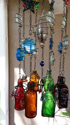 Message in a Bottle Windchime/Suncatcher using small bottles and old candelabra lightbulbs Unique and cool! Looks pretty but not practicle if we get wind. Small Bottles, Bottles And Jars, Glass Bottles, Wine Bottle Crafts, Bottle Art, Carillons Diy, Diy Wind Chimes, Shell Wind Chimes, Message In A Bottle
