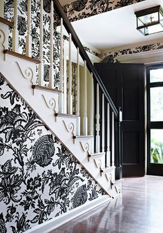 black and white wallpaper, black door