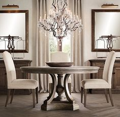 ST. JAMES ROUND DINING TABLE $1795 - $2495 Reimagining architectural elements from the early 19th century, our dining table features intrica...