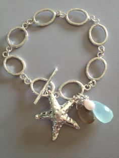 Hand forged and soldered Argentium silver bracelet, with Karen Hill Tribe starfish pendant, and briolettes of gray moonstone, pink Opal, and blue Chalcedony