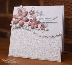 This card is a DT fusion !I used the Vintage Embossing Folder Decadent Roseand Snow White Centura Pearl card with a hint of silver,sentiment is also from the Vintage Floral sentimentsfrom Crafter's Co