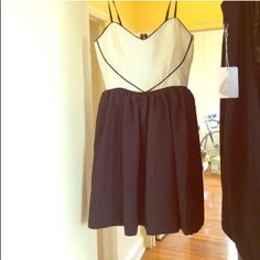 Sweetheart dress Brand new, never worn. Material is made of small black hearts Urban Outfitters Dresses