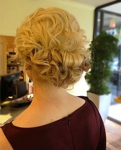 Gorgeous glowing golden updo: proof that a formal style doesn't have to look stiff.  #VanitySalonHouston