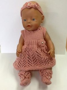 Baby Doll Knitted Lace Dress by Wynona O'neil Pattern for a hand knitted lace dress with pants and socks and headband. Sized to suit 36-40cm (141/2 - 16 inch) doll such as baby born.