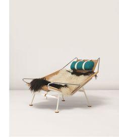 HANS J. WEGNER 'Flag Halyard' armchair, model no. GE225, ca. 1950 Chrome-plated metal, painted metal, halyard, wool, fabric.