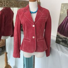 Cute suede crop jacket 100% leather in a rose color with white stitching. Lining has a beautiful flowered pattern. Dalia Jackets & Coats