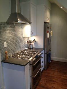 Solistone Mardi Gras (Carrollton) in a white kitchen. This is the same tile we have. This blogger saw ours and got it for her kitchen. Looks great, and it's good to know that if we ever go from dark to white, we can keep the tile!