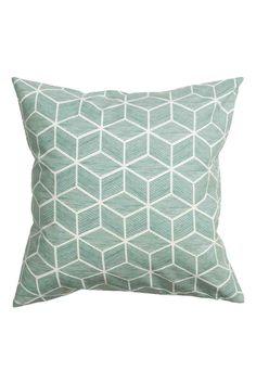 Poszewka na poduszkę z bawełny: Poszewka na poduszkę z bawełnianego diagonalu we wzory. Kryty suwak u dołu.