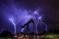 Night of summer storms. Lightning with an oil derrick in the foreground! Somewhere in Texas