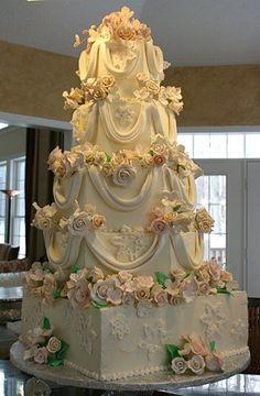 Wedding Cakes Classic Ivory Wedding Cake with Fondant Draping; Extravagant Wedding Cakes, Amazing Wedding Cakes, Elegant Wedding Cakes, Wedding Cake Designs, Amazing Cakes, Huge Wedding Cakes, Elegant Cakes, Wedding Ideas, Fondant Wedding Cakes