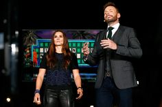 Danica Patrick driver of the GoDaddy Chevrolet talks with television personality Joel McHale perform live a taping of E's 'The Soup' after practice...