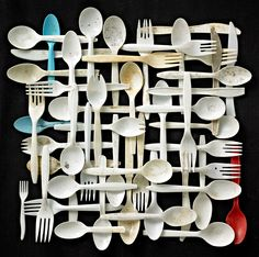"""SUBMISSION: Plastic forks, knives and spoons on black background.  Found objects collected on Floyd Bennett Field, Brooklyn, New York. From the series of photographs """"Found in Nature"""" by Barry Rosenthal."""
