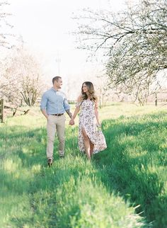 This couple and Daphnae Mae Photography met in a scenic almond orchard for what became these stunning springtime engagement photos!
