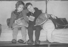 Jewish refugee children, part of a Children's Transport (Kindertransport) from Germany, upon arrival in Harwich. Great Britain, December 12, 1938.    — Institute of Contemporary History and Wiener Library Limited