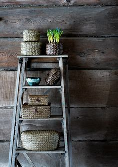 Rustic ladder and baskets with an elegant touch of flowers via ZsaZsa Bellagio