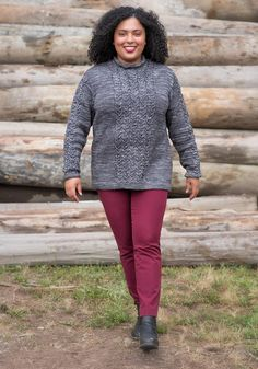 """Classic funnel-neck pullover with mesmerizing cables. DESIGNER: Shaina Bilow Included in your kit is the following: (1) Serenity Worsted (75% super wash superfine merino, 15% cashmere, 10% nylon; approx 175 yds per skein) in the following colourway in Grey Wolf in the appropriate amount for your size.(2) PDF of River Cable Pullover pattern (will be gifted from Ravelry following purchase of kit) Our model is wearing the 47"""" bust size. Sizing & Materials for Pullover: Adult Sizes: 1 (2, 3…"""