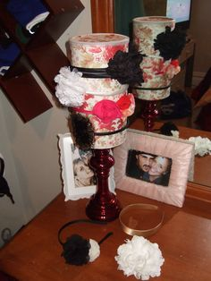 A Head Band Stand!  My 1st Pinterest DIY craft project! :) Sooo Proud!    You will need an oat meal container, a candle pedestal, and 2:12x12 pieces of scarp book paper.  I used gorilla glue for the base of the candle holder and oatmeal box.   I used spray adhesive to attach paper to oat meal box.  I used a 4.6in' circle cut out on a Cricut machine for the top.