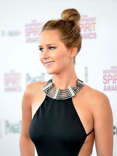 Hair Inspiration: Jennifer Lawrence effortless topknot hairstyle. Here's how to get it. | allure.com