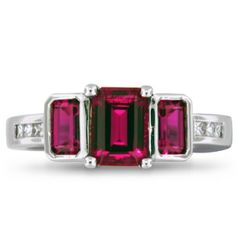 Three beautiful emerald-cut, lab created rubies are the focal point in this striking ring set. Channel and flush set diamond accents on both bands add just the right amount of sparkle to this modern set. Jewelry Box, Jewelry Rings, Jewelery, Jewelry Accessories, Ladies Accessories, Nice Jewelry, Best Friend Jewelry, Ruby Gemstone, Diamond Are A Girls Best Friend