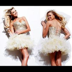New Sherri Hill minidress Ivory/Gold Size 2 Sherri Hill minidress Ivory/Gold Size 2 Glitzy cocktail dress with striking, shimmering bustier. Give them something to talk about by showing up in this dramatic Sherri cocktail dress! Shimmering accents coat the form-fitting bustier, lending it a glitzy and intoxicating ambiance. The skirts translucent and ethereal ruffles complement the bold sweetheart neckline in a captivating way. We only sell 100% authentic dresses... Velocity  Fashion (949)…