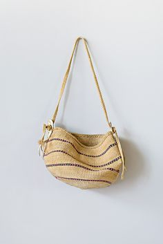 Vintage Sisal Bag with Deer Hide Tassels | $58