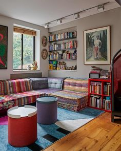 Custom storage, a bold mix of patterns, and colorful furniture make this shared NYC home ultra livable. | House Tours by Apartment Therapy #housetours #hometours #livingroom #livingroomideas #livingroomstorage #storageideas #storagehacks #customstorage #colorfuldecor #nycapartments #nychomes Reclaimed Wood Shelves, Expandable Dining Table, Living Room Storage, Halloween Home Decor, Colorful Furniture, House Rooms, Furniture Making, Living Room Designs, Creative