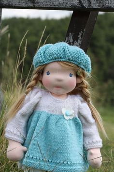 """Darling Lisa is 18″ tall handmade waldorf inspired doll. She is made of all natural fibers. Her body is made of 100% cotton, high quality, double knitted interlock from company """"De witte engel"""" and stuffed with pure carded lamb wool . Her hair is made of mohair weft sewed straight on her head. Her face is needle felted and her eyes are embroidered with cotton thread. Her cheeks are blushed with fully harmless beeswax crayon used in Waldorf pedagogy. Arms and legs are free moveable, she has…"""