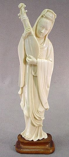 """Chinese carved ivory figure Chinese hand carved ivory figure of woman on a wood base. 9 1/4""""H."""