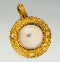 A gold-framed lover's-eye pendant. (aspireauctions.com)