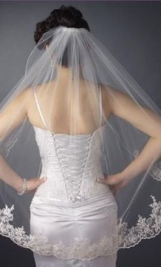 New With Tags/ Unaltered White Veil: buy this dress for a fraction of the salon price on PreOwnedWeddingDresses.com