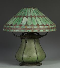 "Grueby Faience Company - Table Lamp. Matte Glazed Pottery Lamp Base with Bronze Mounts and Leaded Glass Lamp Shade. Pottery Decorated by Edith R. Felton. Boston, Massachusetts. Circa 1900. 18"" x 18""."