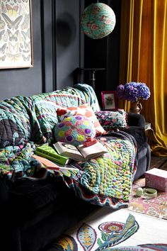 Dark walls, mustard curtains, kitschy patterns and BOOKS. Lots of books.