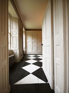 black & white painted wooden floor #architecturalhardware #interiordecoration http://www.motherofpearl.com