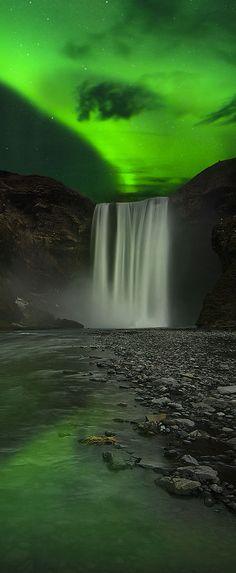 Aurora above Skogafoss waterfall, Iceland