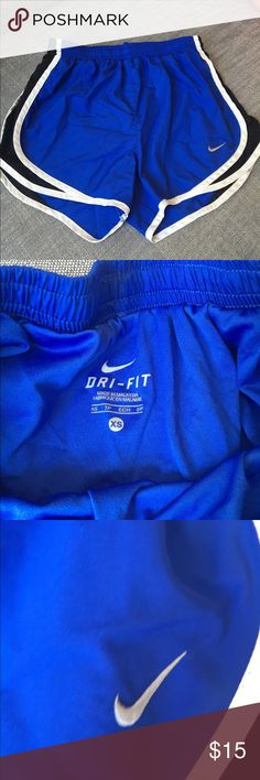 Nike Tempo Running Shorts Running shorts - gently used!  Dri-FIT® fabric wicks sweat away and keeps you dry and comfortable Built-in briefs for ultimate coverage Flat-seam construction minimizes chafing Nike® logo detail for authentic style Fabric: 100% polyester Nike Shorts