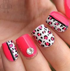 Pink and white leopard nail art design. Pretty looking nail art design with hints of black and gray. A silver bead is also added on top for effect.