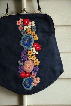 Adorable black oversize coin purse bag with colorful rainbow colored flower embroidery