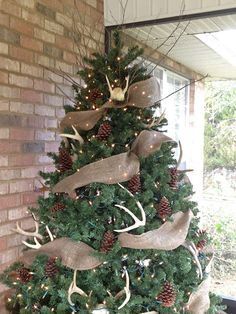 The Rustic Porch Tree: antlers, pinecones and burlap.