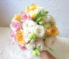 Styled with roses, lisianthus  and other accents.