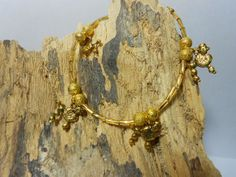 Gold poodle bracelet by Purrwoof on Etsy, $12.00
