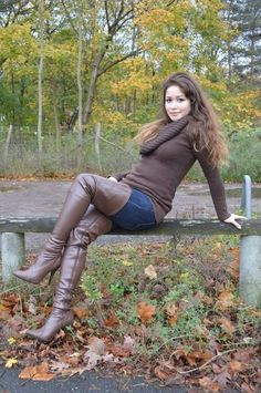 Sexy amateur in brown thigh boots jeans and sweater
