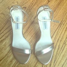 Steve Madden Metallic Gold Heels Steve Madden Metallic Gold heels with ankle strap. Shoes have been worn once and are in great condition. Size 6 Steve Madden Shoes Heels