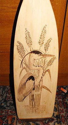 Canoe paddle with ornamental heron - by Nige Ayers