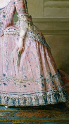 Detail silver and blue floral embroidery to pink silk gown, pannier, bodice, strings of pearls at wrist, ivory fan, ruches to sleeve and lace at elbow, fly fringe/tassle hem, from Carlota Joaquina de Borbón, Infanta of Spain and Queen of Portugal detail, by Salvador Maella, 1785  Copyright ©Museo Nacional del Prado
