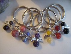 Gemstone Angel Keyrings by AlisonsGemstones on Etsy  Beautiful bright Carnelian, Amethyst, Garnet, Lepidolite,Onyx, Sodalite and Yellow Calcite Angels bringing positive energy along with you. Take an Angel with you on your travel!