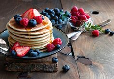Pancakes with fresh berries by Malinkaphoto on @creativemarket