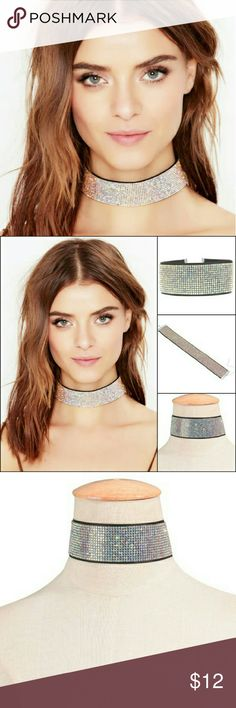 ????RHINESTONE NECK GARTER/CHOKER Shiny rhinestone choker laid on top of black velvet for comfort and style.  Definitely a style piece to add that extra bling to any outfit.  Clasp on back is silver and adjusts to size.  Perfect gift for yourself or a loved one!! ?????? Jewelry Necklaces