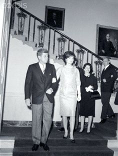 Grand Entrance With Mrs. Kennedy on his arm, President Kennedy walks from the Grand Staircase at the White House through the foyer to the Blue Room for the diplomatic reception for the chiefs of missions and their wives. Following behind are Vice President Lyndon Johnson (partially hidden) and Mrs. Johnson, and Secretary of State Dean Rusk. Mrs. Rusk is hidden.  February 08, 1961 ❤❁❤☀❤☀❤❁❤❁   http://en.wikipedia.org/wiki/John_F._Kennedy…