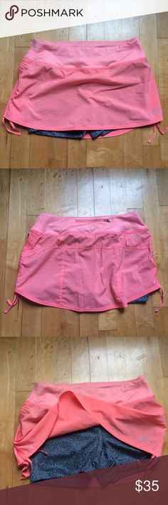 Nike running skirt New without tags and sold out! Built in shorts; key pocket on back. Nike Shorts Skorts