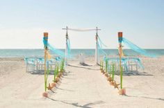 two post bamboo arch with blue sash highlights - a beautiful aisle just waiting for the happy couple